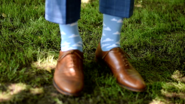 Groom with classic elegant shoes and fancy socks Groom with classic elegant shoes and fancy socks sock stock videos & royalty-free footage