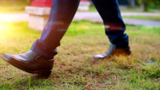 Groom with elegant shoes, focus to foot walk steep. video