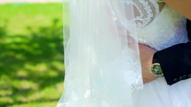 Grooms Hands on Waist of Bride