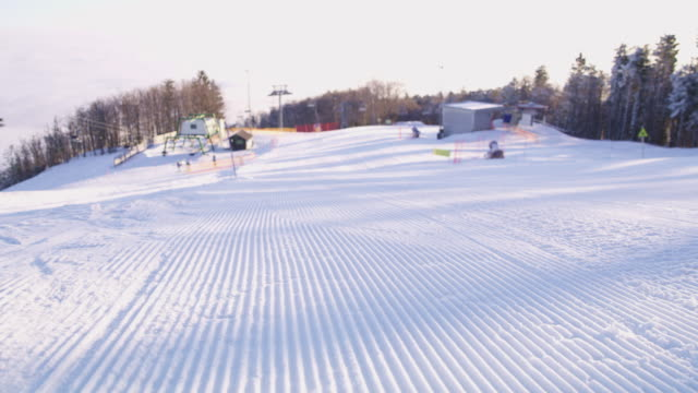 4K Grooves in plowed snowy ski slope, real time video