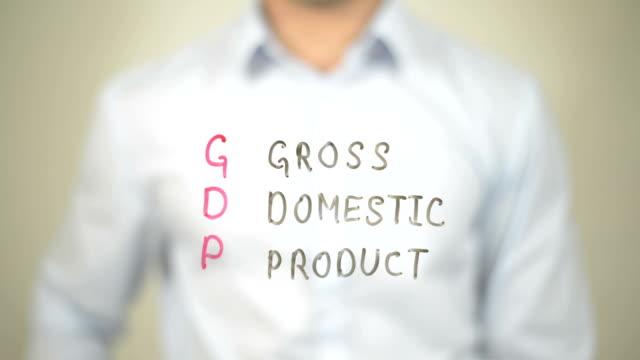 bruttoinlandsprodukt, bip, mann schreiben auf transparenten bildschirm - nutztier oder haustier stock-videos und b-roll-filmmaterial