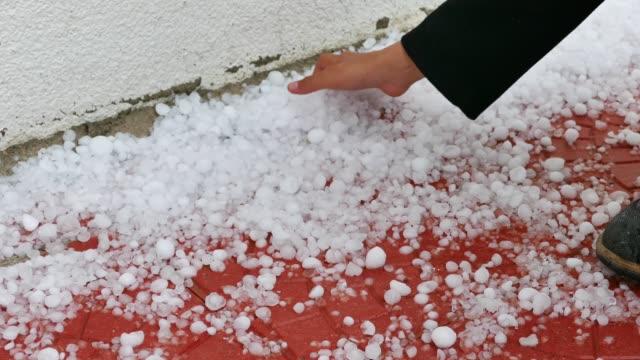 ground level view of hail falling during summer thunderstorm. - grandine video stock e b–roll