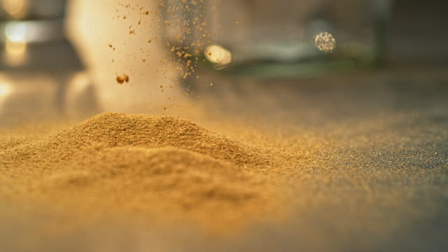 SLO MO LD Ground spice on a flat surface Slow motion close up locked down shot of powdered brown spice on a flat surface. Shot in Slovenia. ginger spice stock videos & royalty-free footage