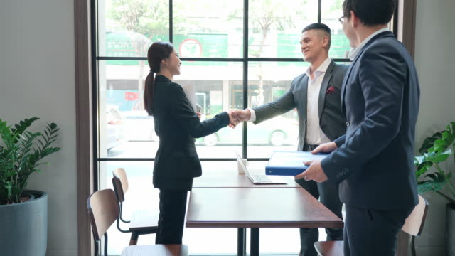 Group Business people greet shake hands Before meeting. They share idea, Brainstorming in cafe. Business Teamwork concept