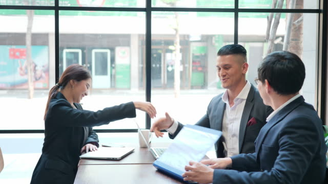 Group Business people shake hands after reaching a business agreement in cafe. Business success concept
