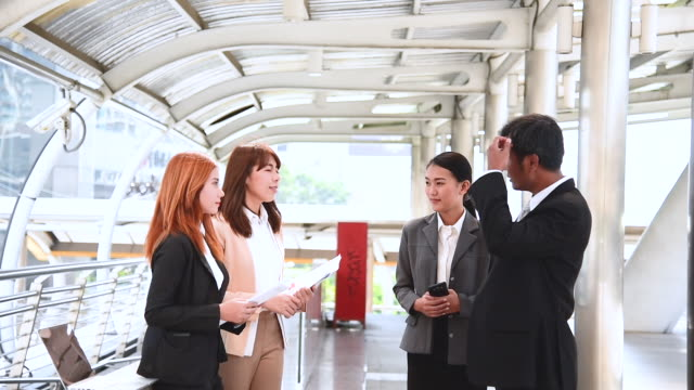 Group diversity partner business meeting trust in businessman and tam talking together modern city asian Teamwork Collaboration Team Meeting Communication concept with Business people Working Together