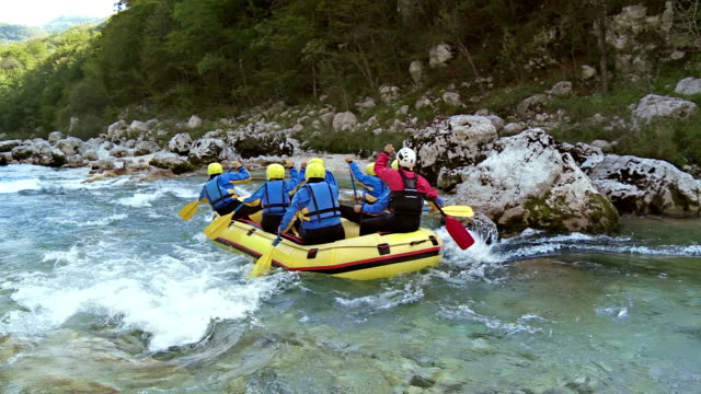 HD: Group Enjoying White Water Rafting HD1080p: Whitewater rafters splashing through the river rapids while rafting on the rough water. guidance stock videos & royalty-free footage