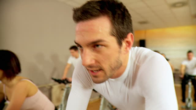 HD: Group Exercise On Spinning Bikes video