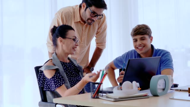 Group meeting of creative business people, designer and artist at office desk. Group meeting of creative business people, designer and artist at office desk. Happy workplace and collaboration teamwork concept. employee engagement stock videos & royalty-free footage
