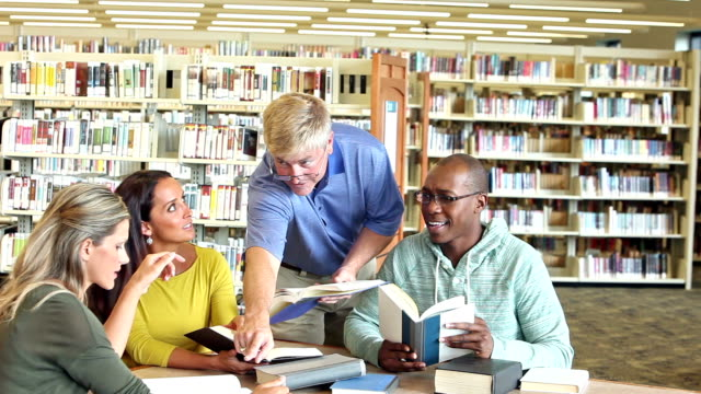 Group of adult students studying in library video