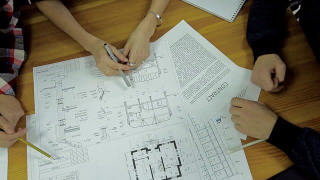 Group of Architects Planning on a New Project with their Blueprint video