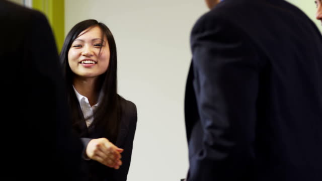Group of Asian businesspeople shake hands video