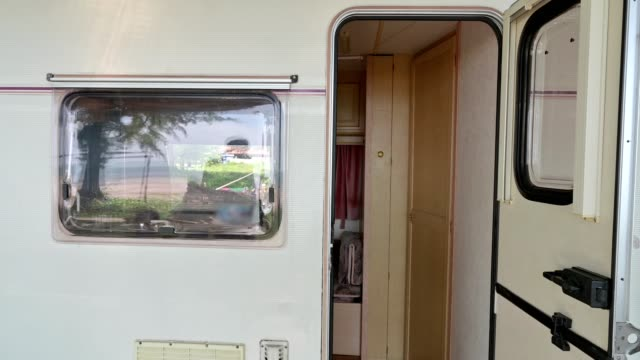 Group of asian friends running leave of camper van on vacation