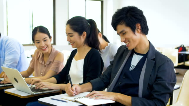 Group of Asian students are studying in classroom, learning and education concept Group of Asian students are studying in classroom, learning and education concept thai ethnicity stock videos & royalty-free footage