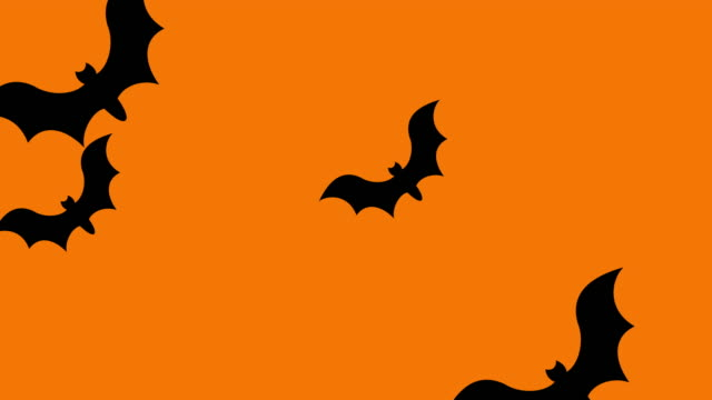 group of bats flying from one side to another on orange background. - halloween background filmów i materiałów b-roll