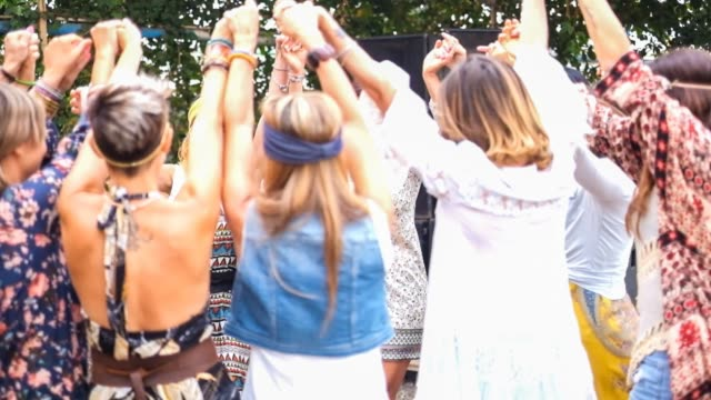 Group of beautiful friends women dancing and stay together having fun Group of beautiful friends women dancing and stay together having fun. People free with colorful and hippy fashion clothes hippie stock videos & royalty-free footage