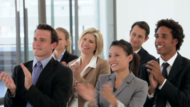 Group Of Business People Applauding Speaker At A Presentation video