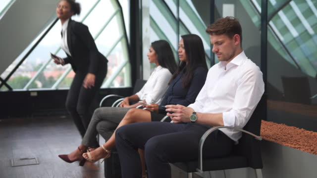 Group of business people waiting for an interview Group of business people waiting for an interview at the office job interview stock videos & royalty-free footage