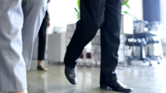 Group Of Business People Walking Through Modern Office Building Bottom View, Team Of Successful Businessmen And Businesswomen video