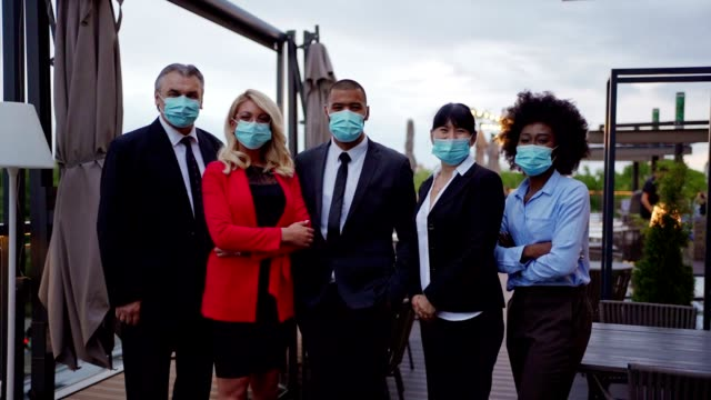 group of business people wearing protective mask - businessman covid mask video stock e b–roll