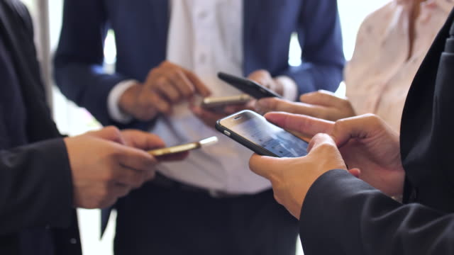 Group of Business people with smart phone phones, Social Media video