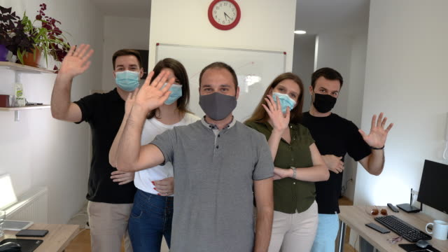 Group of business persons with face masks