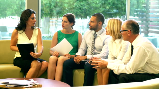 Group Of Businesspeople Having Meeting In Office Lobby video