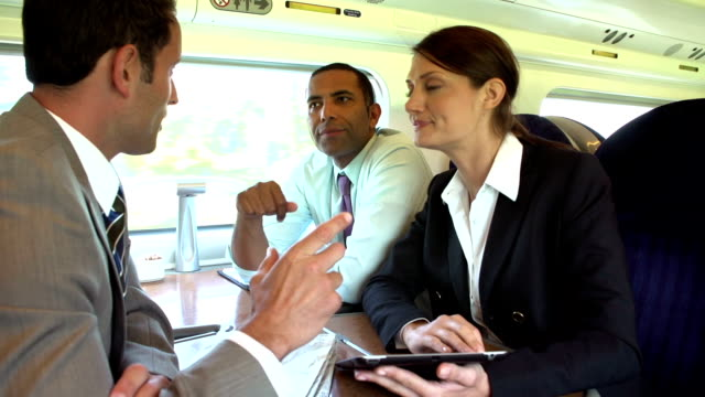 Group Of Businesspeople Having Meeting On Train video