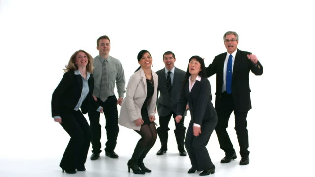 Group of businesspeople jump and celebrate, slow motion video