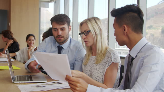 Group Of Businesspeople Meeting Around Table In Boardroom video