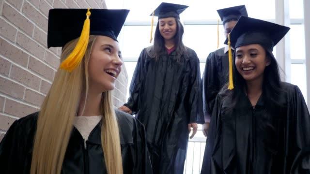 group of cheerful graduates - celebrazione della laurea video stock e b–roll