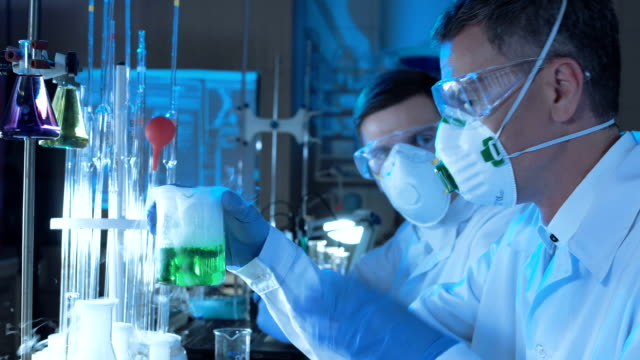 Group of chemists working in a laboratory video