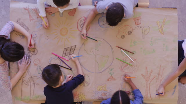 group of children color environmentally conscious mural - sustainability video stock e b–roll