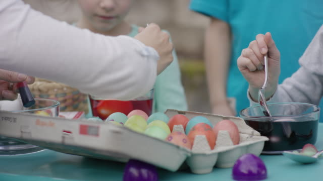 Group of children decorating Easter eggs video