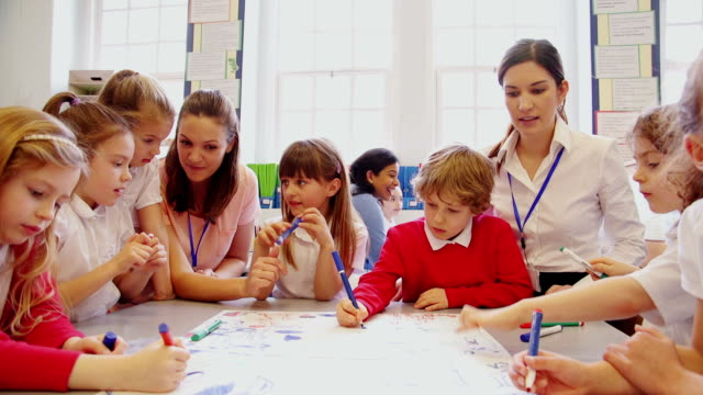 group of children drawing in class - primary school stock videos and b-roll footage