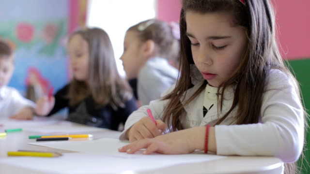 Group of children in the classroom drawing video