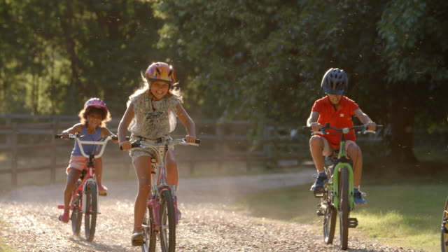 Group Of Children On Cycle Ride In Countryside Together video
