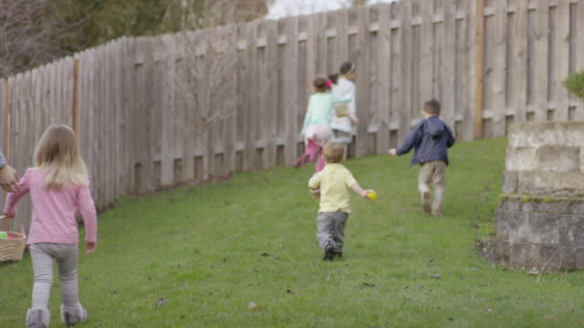 Group of children searching for Easter eggs video