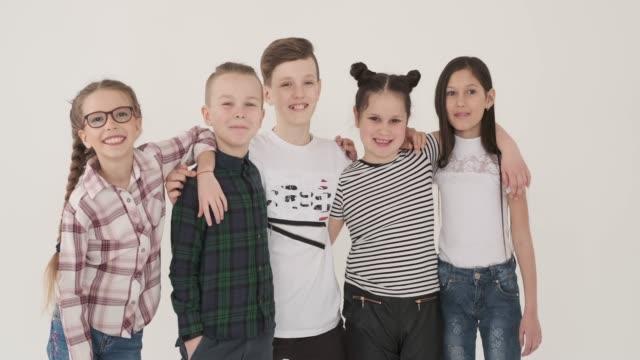 Group of children smiling in studio video
