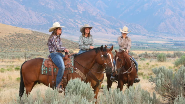 Group of Cowboys and Cowgirls on Horseback Group of young cowboys and cowgirls waiting with their horses cowgirl stock videos & royalty-free footage
