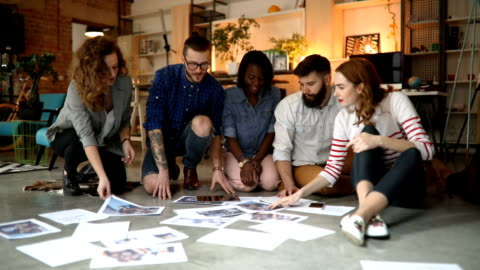 Group of creative people working on floor in office Group of creative people working on floor in office creativity stock videos & royalty-free footage