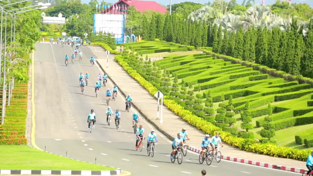 Group of cyclists On street for campaign in  Thailand video