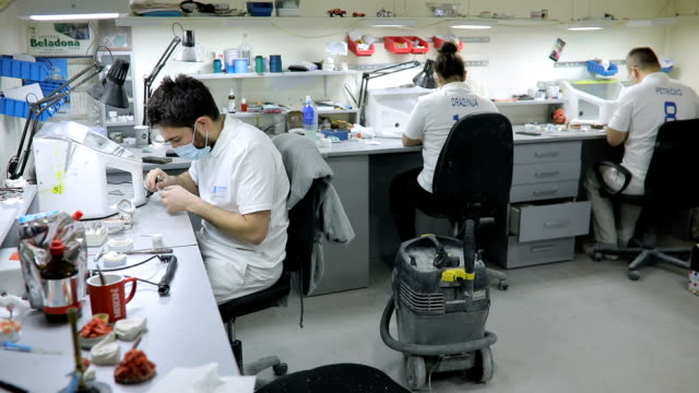Group of dental technicians working