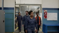 istock Group of diverse industrial laborers walking into the factory ready to work 1206325435