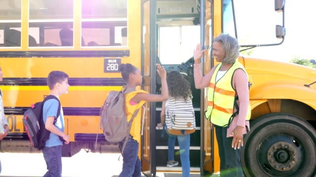 group of diverse mixed aged school children board school bus - bus driver stock videos and b-roll footage