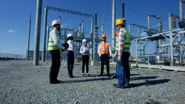 Group of diverse workers on solar plant