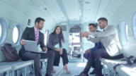 istock Group of executives discuss labor issues in helicopter 1175048913