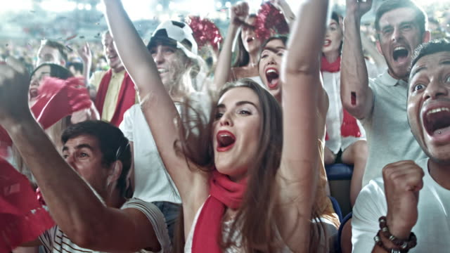 Group of fans cheering for sports team video
