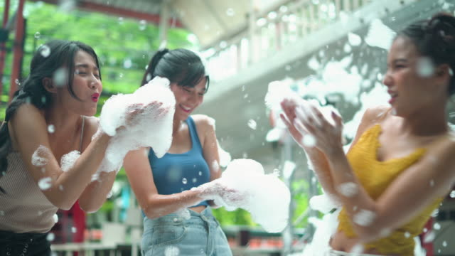 group of female friends blowing the soap sud at party - amicizia tra donne video stock e b–roll