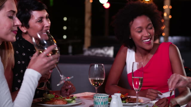 Group Of Female Friends Enjoying Meal At Rooftop Restaurant video